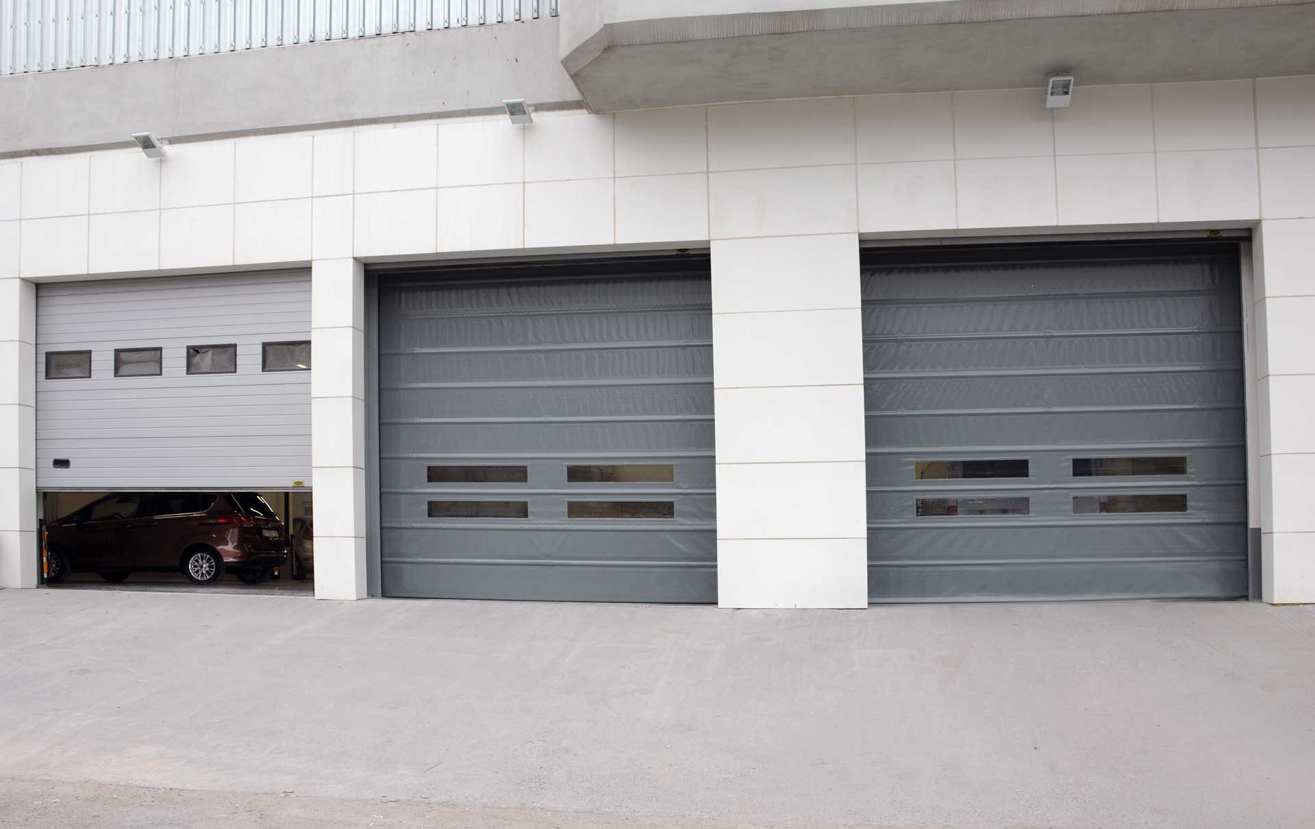 VOLVO CARS – SECTIONAL DOORS & HIGH SPEED PVC ROLLER SHUTTER DOORS