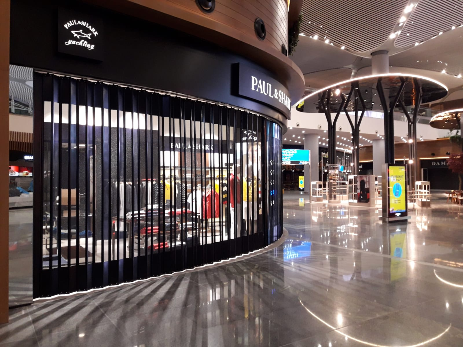 PAUL SHARK 3. AIRPORT DUTY FREE AREA – SLIDING FOLDING SHUTTER SYSTEM